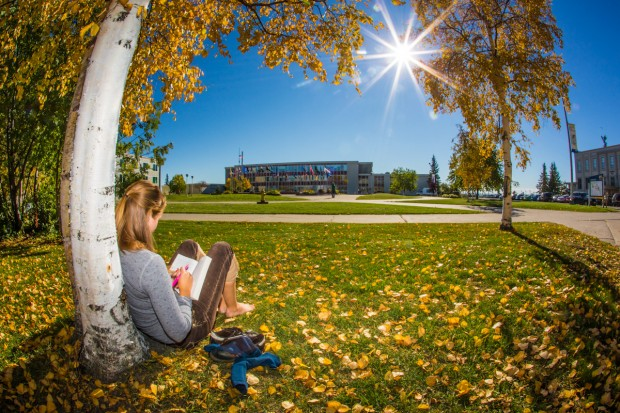 Emily Russell, a new graduate student in Northern Studies, takes advantage of nice September weather on the Fairbanks campus.